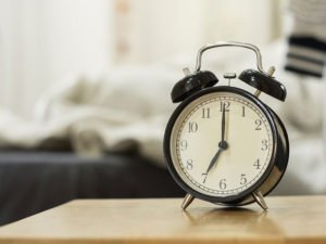 Retro black alarm clock show 7 o'clock in the morning for wake u
