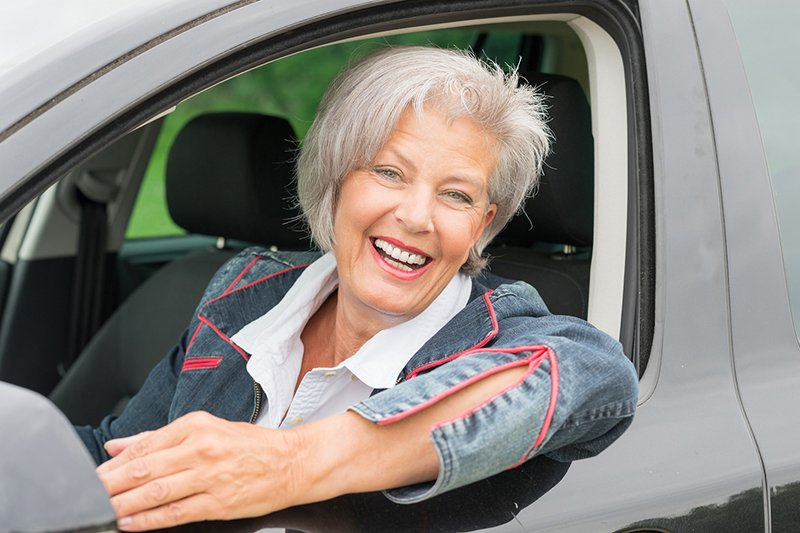 senior driving a vehicle