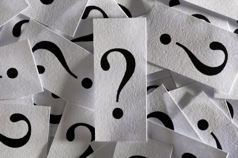 question marks printed on paper