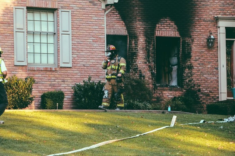 fireman exiting a house