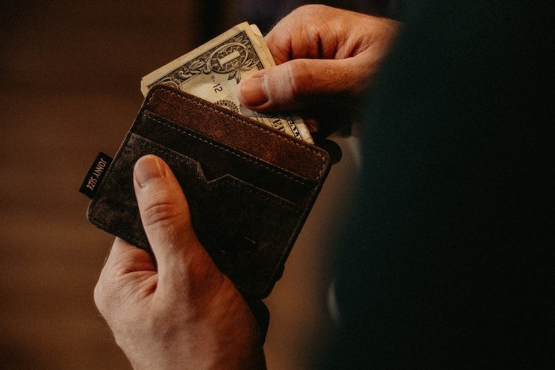 a wallet with a one dollar bill